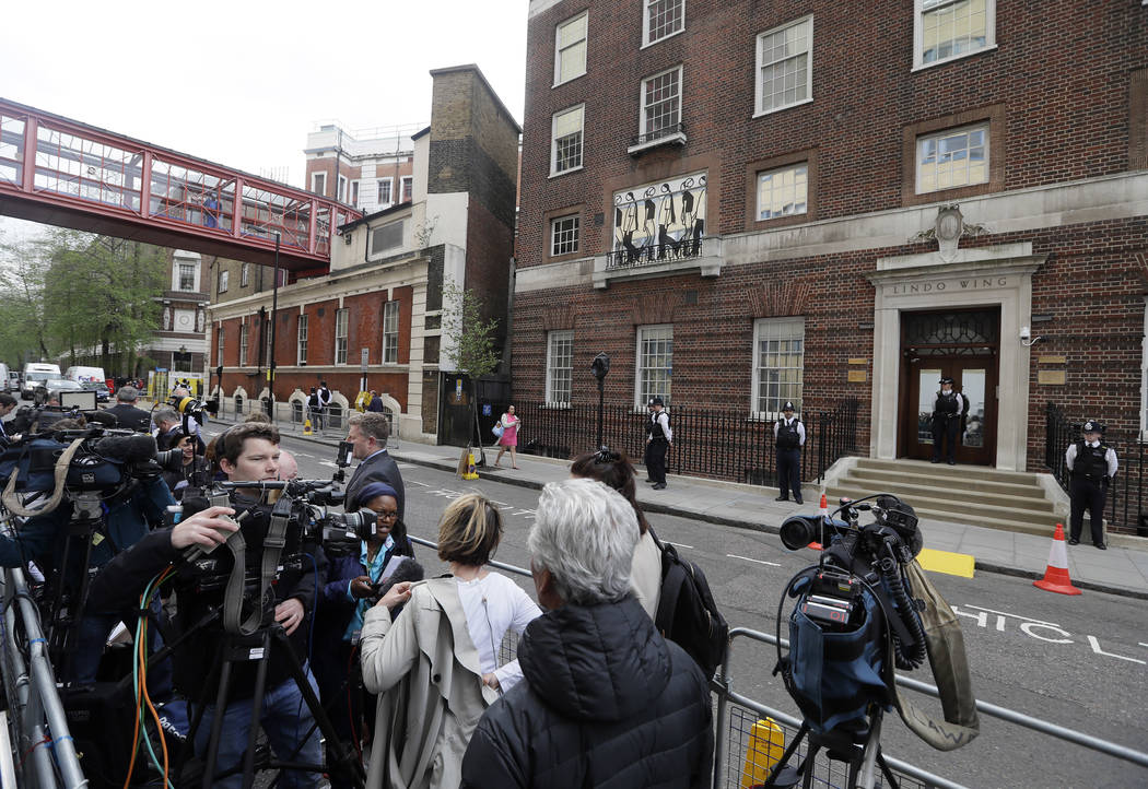 The media gathers opposite the Lindo wing at St Mary's Hospital in London London, Monday, April 23, 2018. Kensington Palace says Prince William's wife, the Duchess of Cambridge has entered a Londo ...