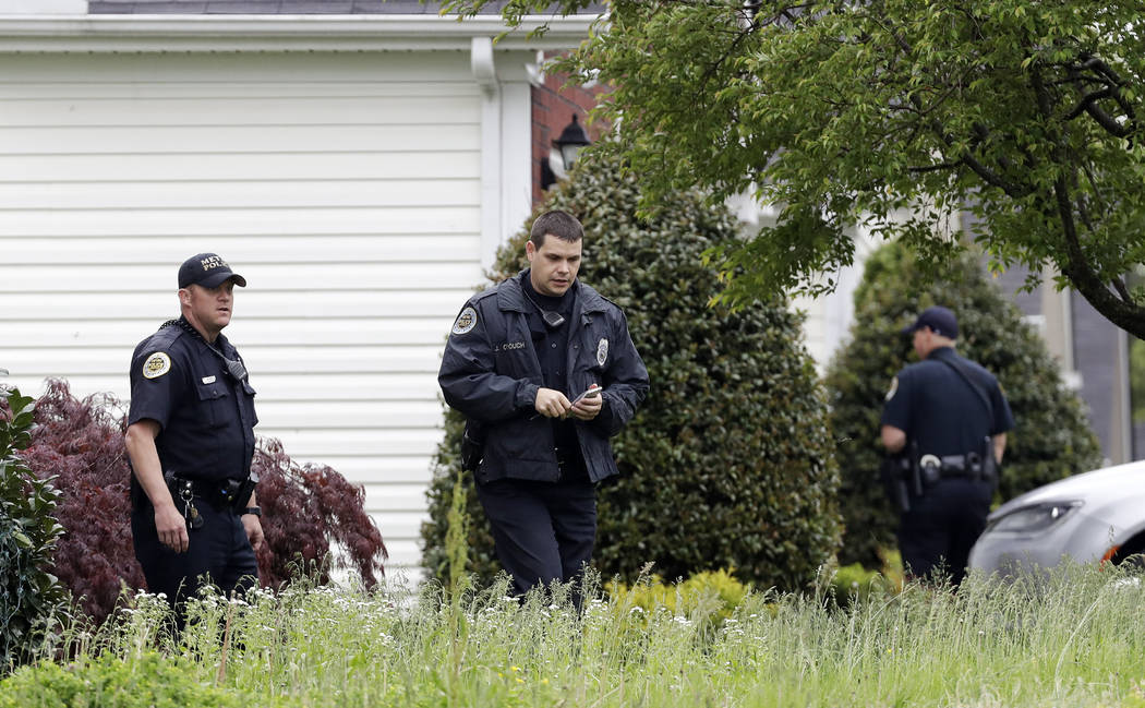 Nashville police officers search a neighborhood near a Waffle House restaurant Sunday, April 22, 2018, in Nashville, Tenn. At least four people died after a gunman opened fire at the restaurant ea ...