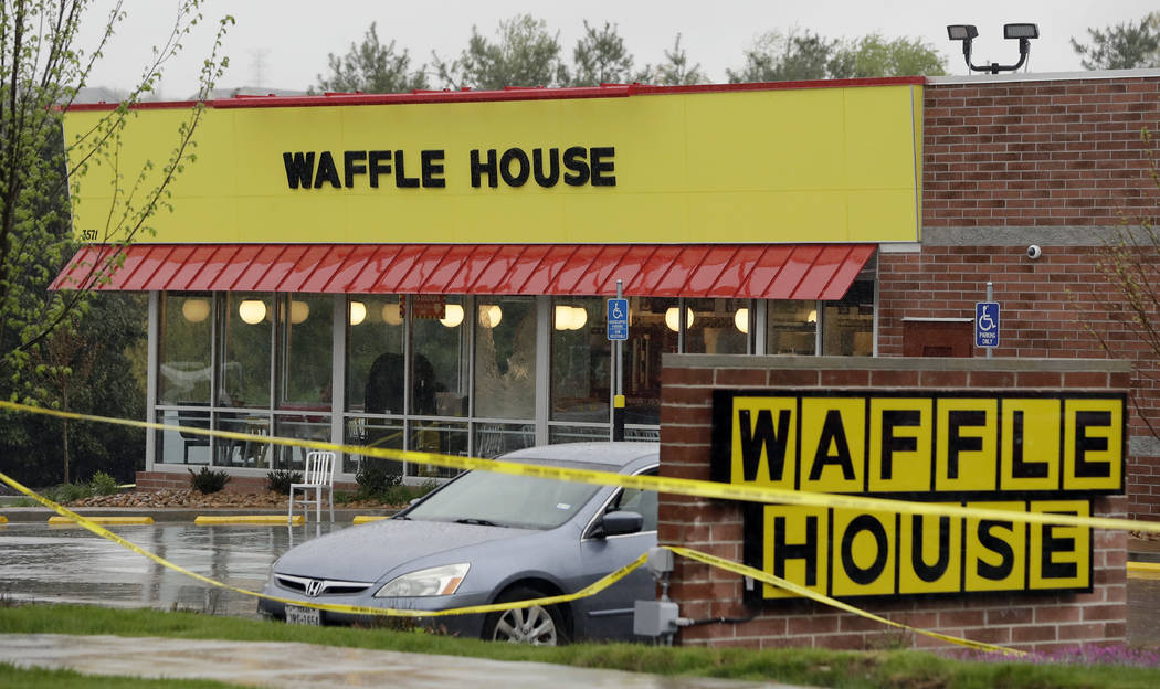 Police tape blocks off a Waffle House restaurant Sunday, April 22, 2018, in Nashville, Tenn. At least four people died after a gunman opened fire at the restaurant early Sunday. (Mark Humphrey/AP)