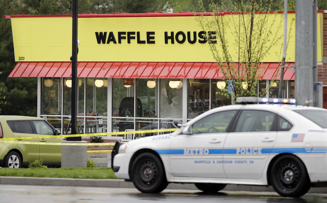A police car sits in front of a Waffle House restaurant Sunday, April 22, 2018, in Nashville, Tenn. At least four people died after a gunman opened fire at the restaurant early Sunday. (Mark Humph ...