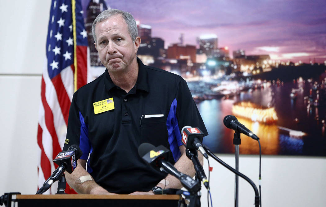 Waffle House CEO Walt Ehmer pauses while speaking during a press conference on the Waffle House shooting Sunday, April 22, 2018 in Nashville, Tenn. (Wade Payne/The Tennessean via AP)
