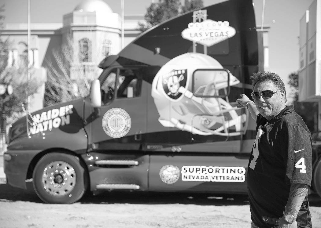 Tommy White, an official with the Laborers International Union of North America Local 872, poses with his Las Vegas Raiders themed 18-wheeler parked near the Nevada Legislative Building in Carson ...