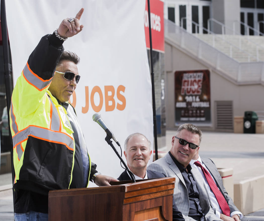 Laborers Union Local 872 chief Tommy White speaks during a rally in support of the stadium, Monday, Oct. 3, 2016, at the Thomas & Mack Center. Also in the photo is Steve Hill,center, chairman of S ...