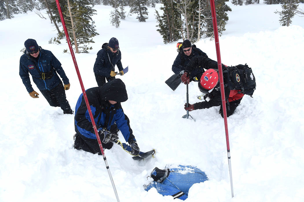 Members of the Mt. Rose Ski Patrol and the North Lake Tahoe Fire Protection District conduct avalanche rescue training near the top of the Mt. Rose Highway pass in Nevada, Jan. 25, 2017. The team ...