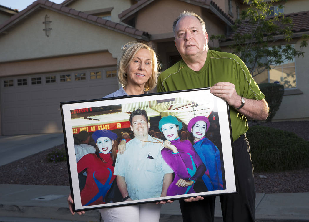Wayne Bernath and his wife, Peggy Bernath, hold a photograph of their 37-year-old son, Wayne Bernath, who died in December from the flu outside their home in Henderson on Monday, April 23, 2018. R ...