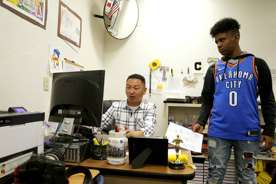 Clark High School teacher Charlie Tang with student Kidus Gebremichael at the end of class Tuesday, April 24, 2018. K.M. Cannon Las Vegas Review-Journal @KMCannonPhoto