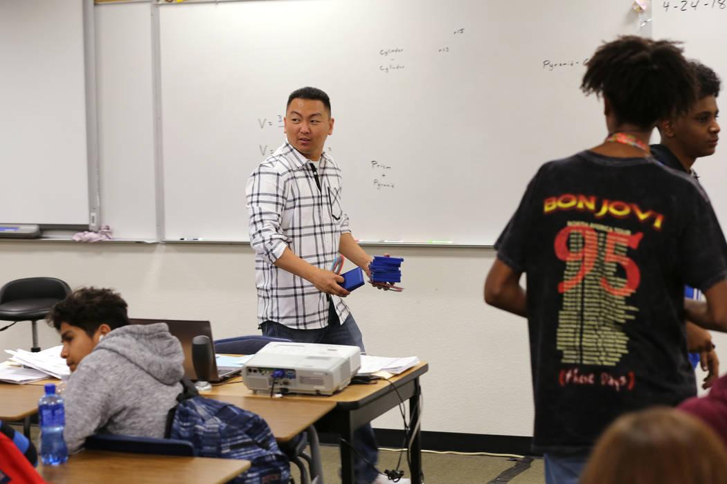 Clark High School teacher Charlie Tang gathers calculators after geometry class Tuesday, April 24, 2018. K.M. Cannon Las Vegas Review-Journal @KMCannonPhoto