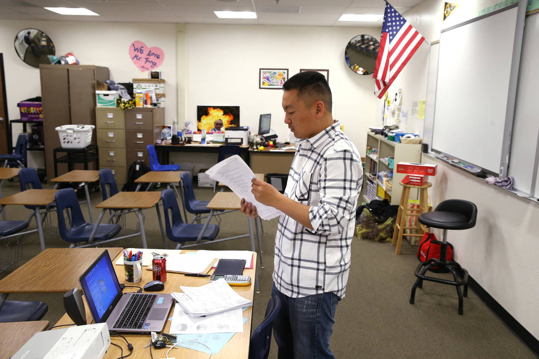 Clark High School teacher Charlie Tang cleans up after geometry class Tuesday, April 24, 2018. K.M. Cannon Las Vegas Review-Journal @KMCannonPhoto