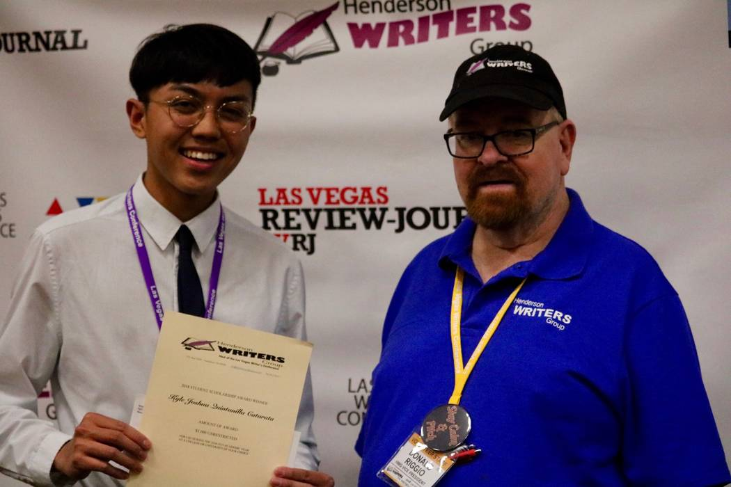 "Kyle ""Kai"" Catarata and Henderson Writer's Group Vice President Donald Riggio at the Las Vegas Writer's Conference banquet at the Tuscany Suites and Casino in Las Vegas on Saturday, April 23. (Mad ..."