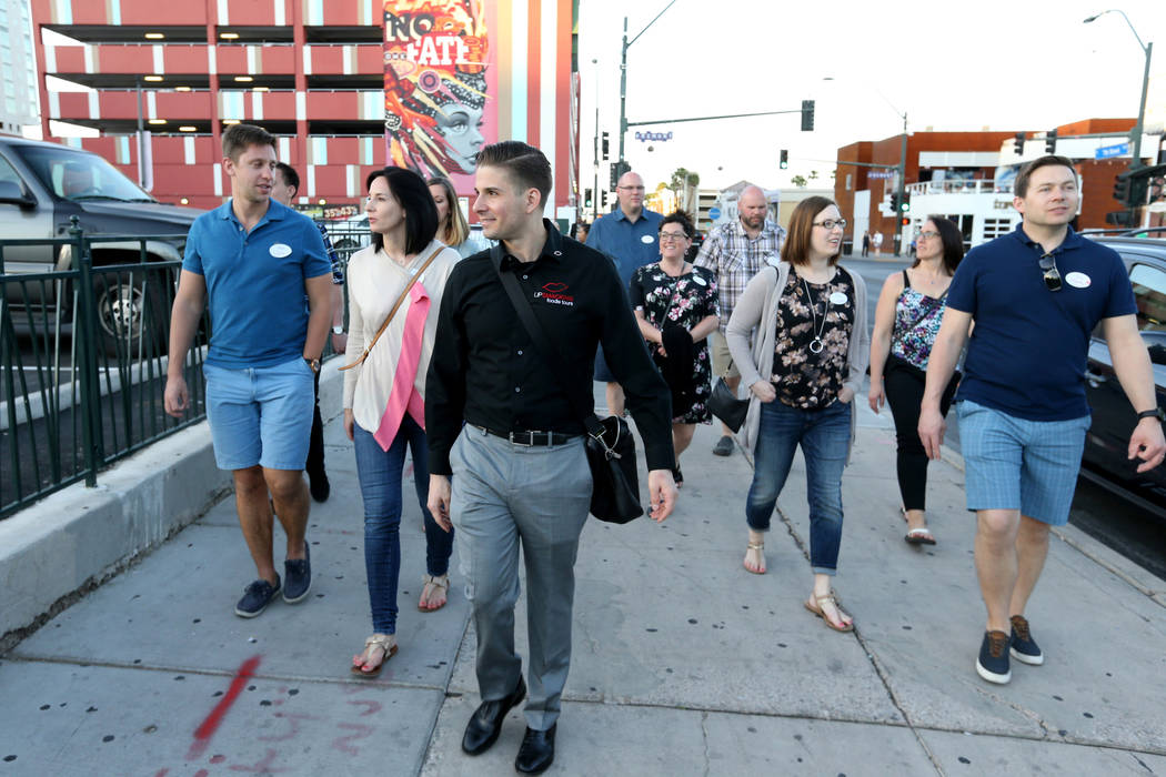 Lip Smacking Foodie Tours President Donald Contursi, third from left, leads a group on Seventh Street to the 7th & Carson restaurant in downtown Las Vegas Friday, April 20, 2018. K.M. Cannon L ...