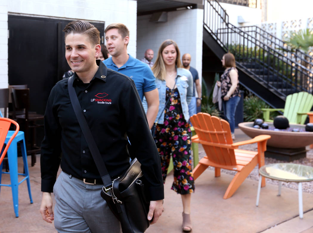 Lip Smacking Foodie Tours President Donald Contursi, left, leads a group after a food and beverage stop at Carson Kitchen in downtown Las Vegas Friday, April 20, 2018. K.M. Cannon Las Vegas Review ...