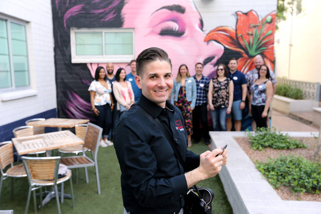Lip Smacking Foodie Tours President Donald Contursi prepares to take a group photo after a food and beverage stop at Carson Kitchen in downtown Las Vegas Friday, April 20, 2018. K.M. Cannon Las Ve ...