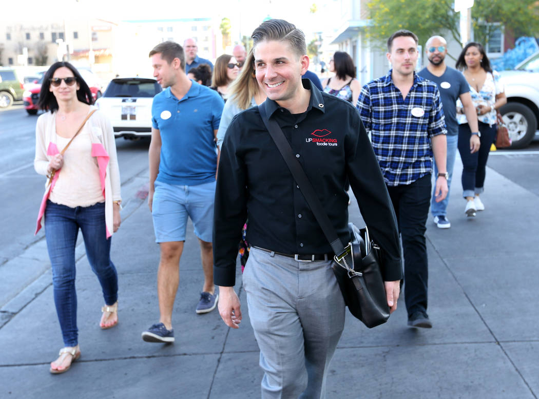 Lip Smacking Foodie Tours President Donald Contursi, center, leads a group after a food and beverage stop at Carson Kitchen in downtown Las Vegas Friday, April 20, 2018. K.M. Cannon Las Vegas Revi ...