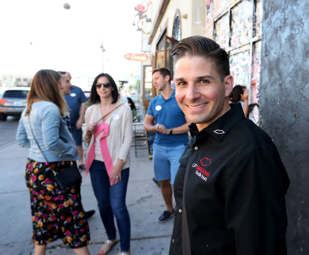 Lip Smacking Foodie Tours President Donald Contursi leads a group after a food and beverage stop at Carson Kitchen in downtown Las Vegas Friday, April 20, 2018. K.M. Cannon Las Vegas Review-Journa ...