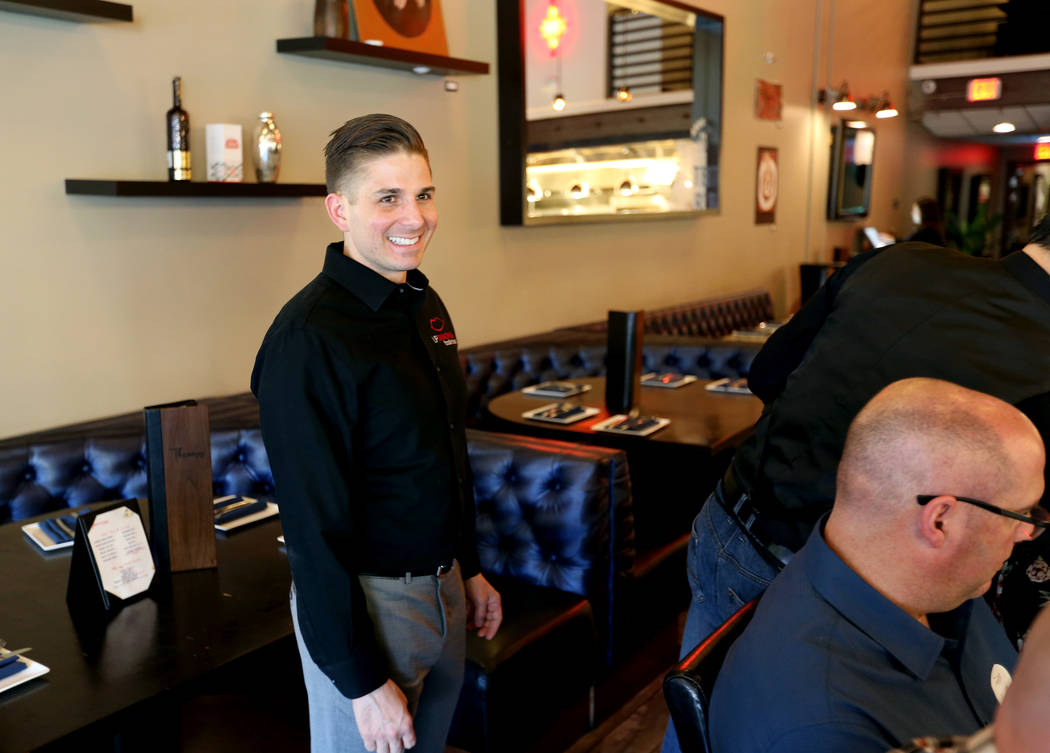 Lip Smacking Foodie Tours President Donald Contursi, left, with a group during a food and beverage stop at Therapy in downtown Las Vegas Friday, April 20, 2018. K.M. Cannon Las Vegas Review-Journa ...