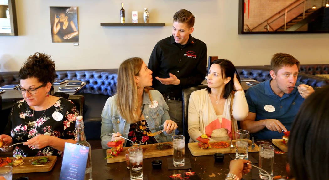 Lip Smacking Foodie Tours President Donald Contursi, standing, with, from left, Alison O'Neill, Kira Stasiuk, Melissa Stasiuk and Chris Stasiuk during a food and beverage stop at Therapy in downto ...