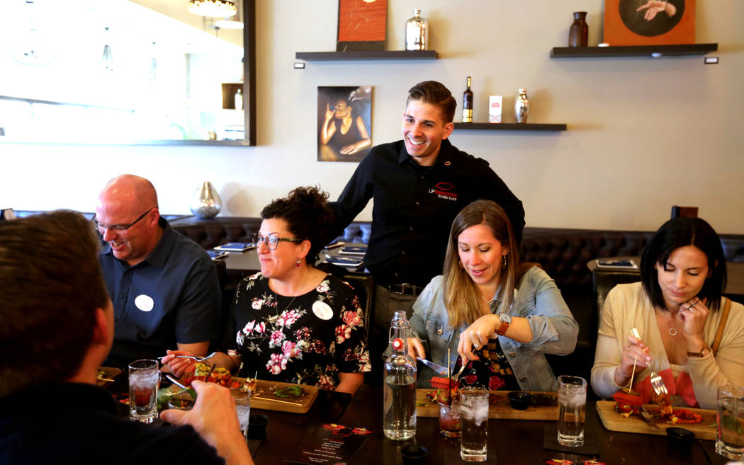 Lip Smacking Foodie Tours President Donald Contursi, standing, with, from left, Greg O'Neill, Alison O'Neill, Kira Stasiuk and Melissa Stasiuk during a food and beverage stop at Therapy in downtow ...