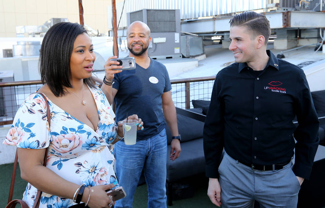 Lip Smacking Foodie Tours President Donald Contursi, left, with DeWana Williams, left, and Bryon Wallington of Atlanta during a beverage stop on the rooftop patio at Inspire in downtown Las Vegas ...