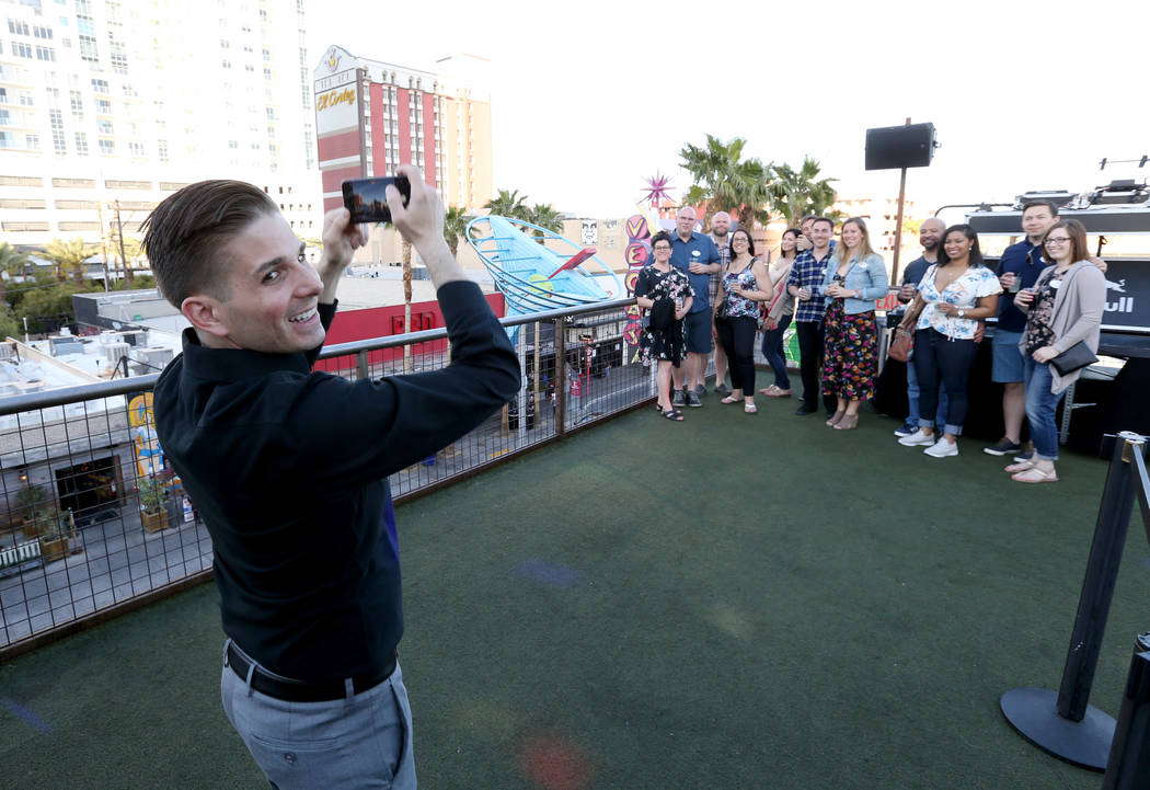 Lip Smacking Foodie Tours President Donald Contursi, left, takes a group photo during a beverage stop on the rooftop patio at Inspire in downtown Las Vegas Friday, April 20, 2018. K.M. Cannon Las ...
