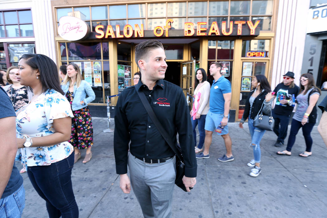 Lip Smacking Foodie Tours President Donald Contursi, center, leads a group at Fremont East in downtown Las Vegas Friday, April 20, 2018. K.M. Cannon Las Vegas Review-Journal @KMCannonPhoto