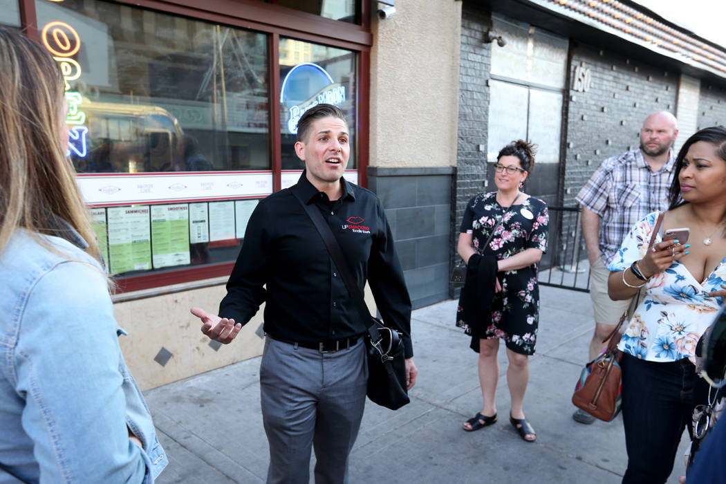 Lip Smacking Foodie Tours President Donald Contursi, left, leads a group at The Market at Fremont East in downtown Las Vegas Friday, April 20, 2018. K.M. Cannon Las Vegas Review-Journal @KMCannonPhoto