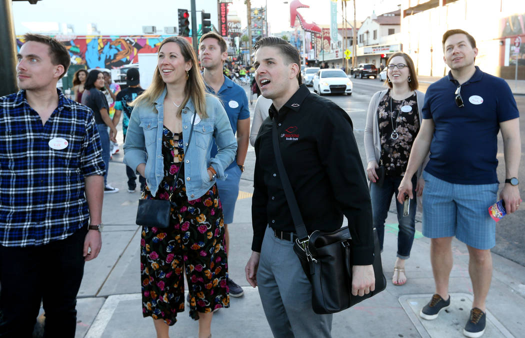 Lip Smacking Foodie Tours President Donald Contursi, third from right, leads a group on in front of Downtown Container Park in Las Vegas Friday, April 20, 2018. With Contursi are, from left, Kyle ...