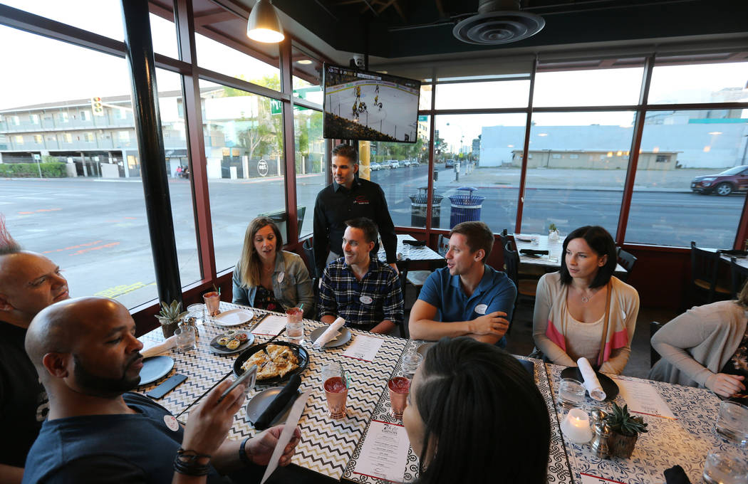 Lip Smacking Foodie Tours President Donald Contursi, standing rear, leads a group at 7th & Carson in downtown Las Vegas Friday, April 20, 2018. K.M. Cannon Las Vegas Review-Journal @KMCannonPhoto