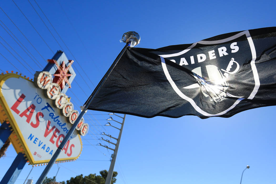 A Raiders flag blows in the wind during a draft day party for the Raiders at the welcome to Las Vegas sign on Saturday, April 29, 2017, in Las Vegas. Brett Le Blanc Las Vegas Review-Journal @blebl ...