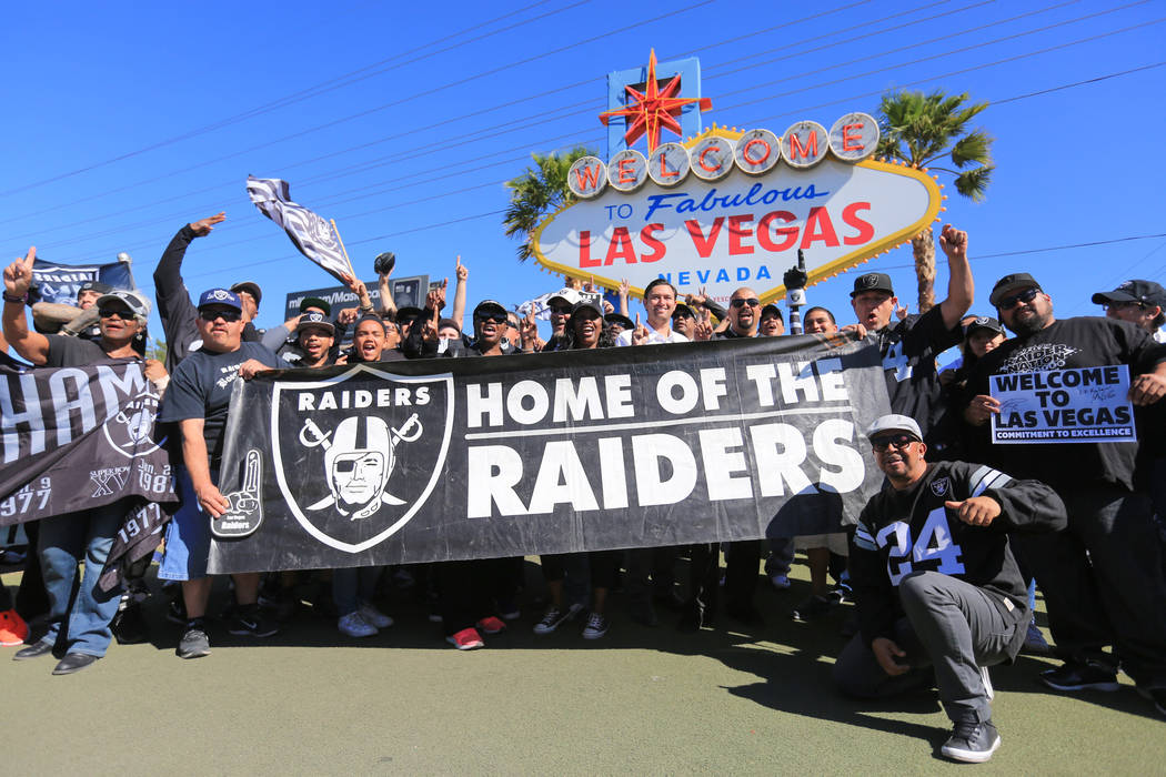 Fans celebrate the Raiders moving to Las Vegas during a during a draft day party for the Raiders at the welcome to Las Vegas sign on Saturday, April 29, 2017, in Las Vegas. Brett Le Blanc Las Vega ...