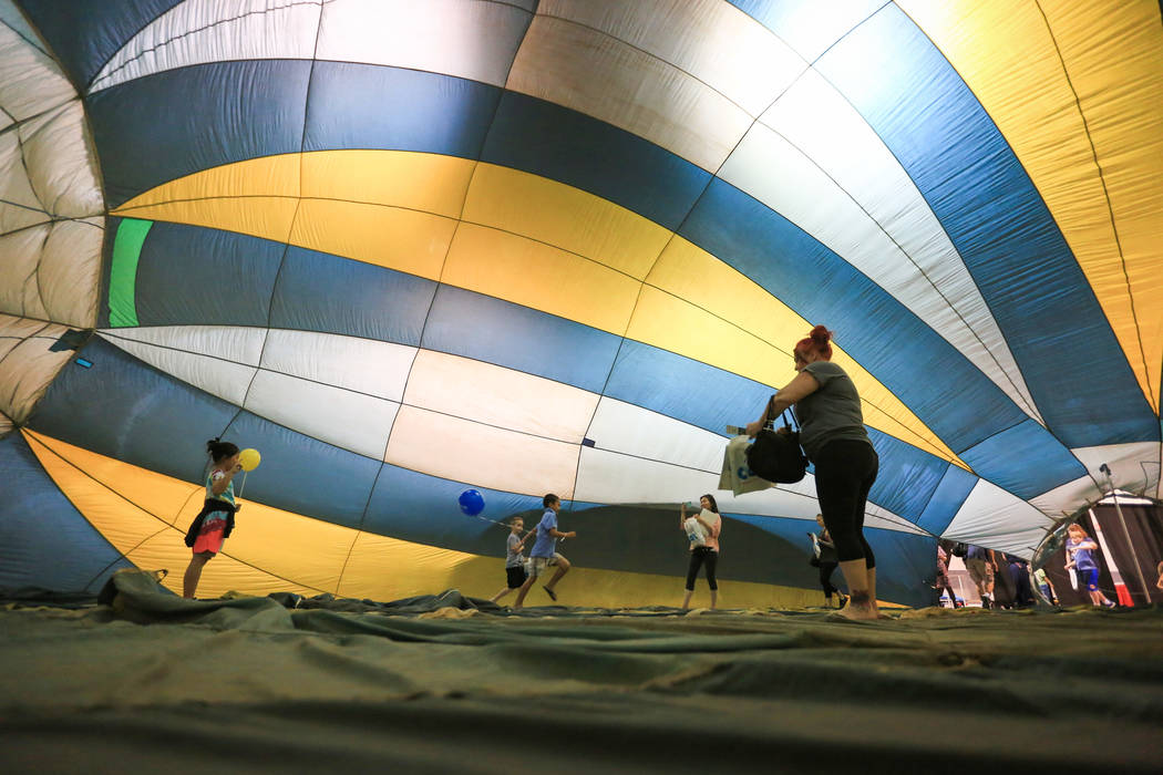 Kids play in a half-inflated hot air balloon at the Las Vegas Science and Technology Festival at the Cashman Center in Las Vegas on Saturday, May 6, 2017. (Brett Le Blanc/Las Vegas Review-Journal ...