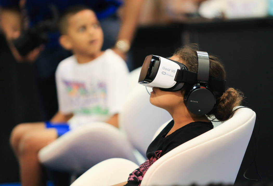 Kesia Hyman, 7, experiences a virtual reality simulation at the Las Vegas Science and Technology Festival at the Cashman Center in Las Vegas on Saturday, May 6, 2017.(Brett Le Blanc/Las Vegas Revi ...