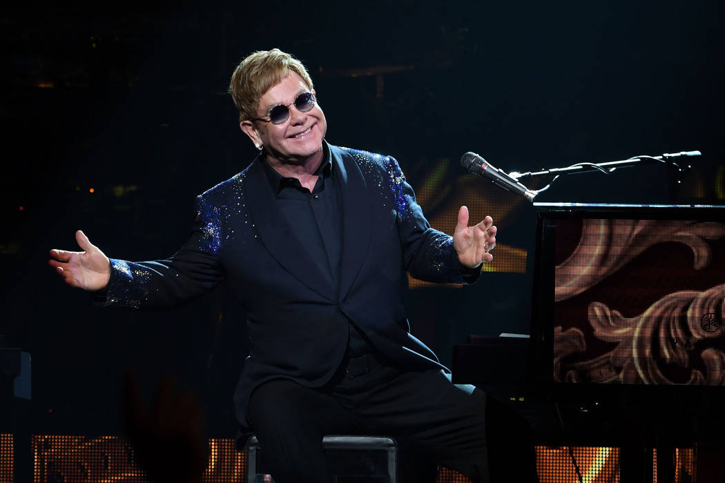 """Elton John performs """"The Million Dollar Piano"""" at The Colosseum at Caesars Palace in Las Vegas on New Year's Eve December 31, 2016 in Las Vegas, Nevada. (Photo by Denise Truscello/WireImage)"""