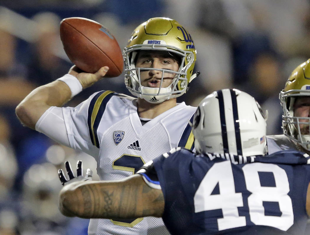 c0a448ad443 UCLA quarterback Josh Rosen (3) throws in the first half during an NCAA  college