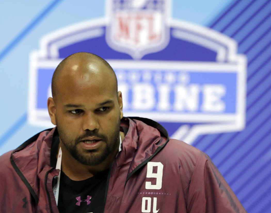 Oregon offensive lineman Tyrell Crosby speaks during a press conference at the NFL football scouting combine, Thursday, March 1, 2018, in Indianapolis. (AP Photo/Darron Cummings)