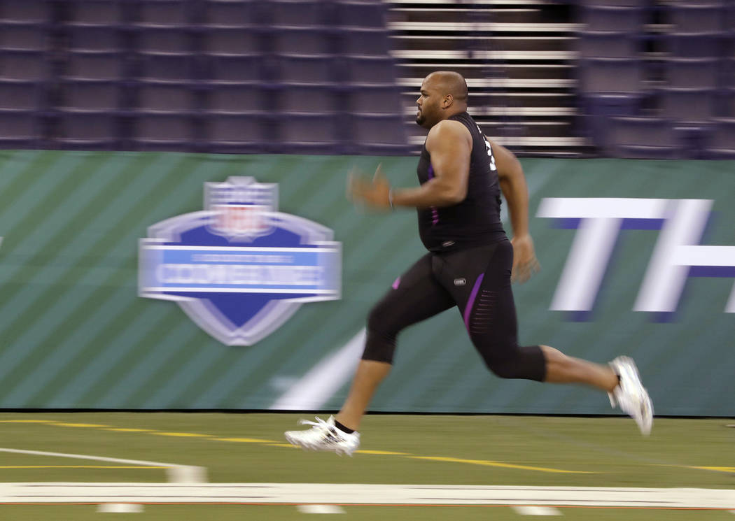 Oregon offensive lineman Tyrell Crosby runs the 40-yard dash during the NFL football scouting combine, Friday, March 2, 2018, in Indianapolis. (AP Photo/Darron Cummings)