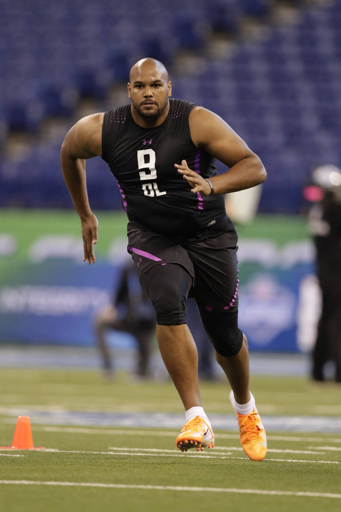 Oregon offensive lineman Tyrell Crosby runs a drill at the NFL football scouting combine in Indianapolis, Friday, March 2, 2018. (AP Photo/Michael Conroy)