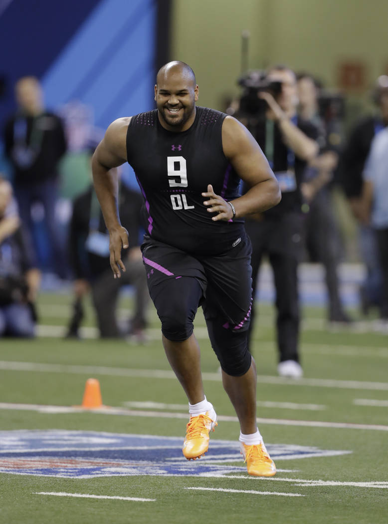 Oregon offensive lineman Tyrell Crosby runs a drill during the NFL football scouting combine, Friday, March 2, 2018, in Indianapolis. (AP Photo/Darron Cummings)
