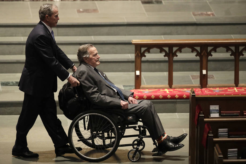 Former Presidents George W. Bush, left, and George H.W. Bush arrive at St. Martin's Episcopal Church for the funeral for former first lady Barbara Bush, Saturday, April 21, 2018, in Houston. Georg ...