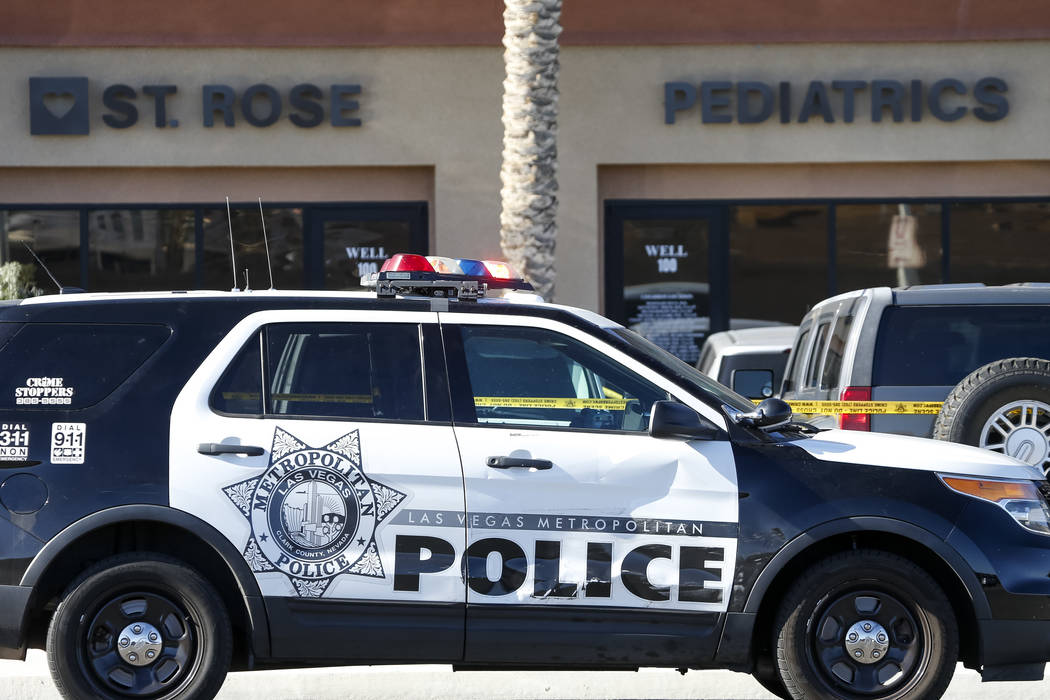 Police investigate the scene where a child suffered critical injuries after being hit by a vehicle in the parking of a pediatrics center near South Buffalo Drive and the 215 Beltway in Las Vegas o ...