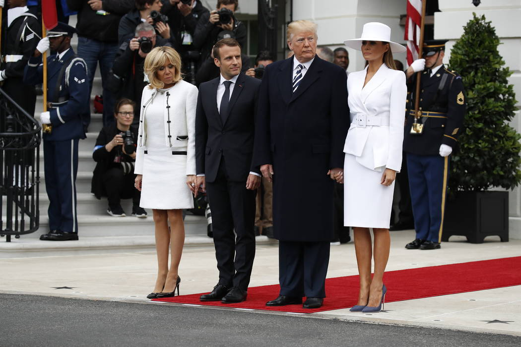 President Donald Trump, first lady Melania Trump, French President Emmanuel Macron and his wife, Brigitte Macron, stand together at the beginning of the State Arrival Ceremony at the White House i ...