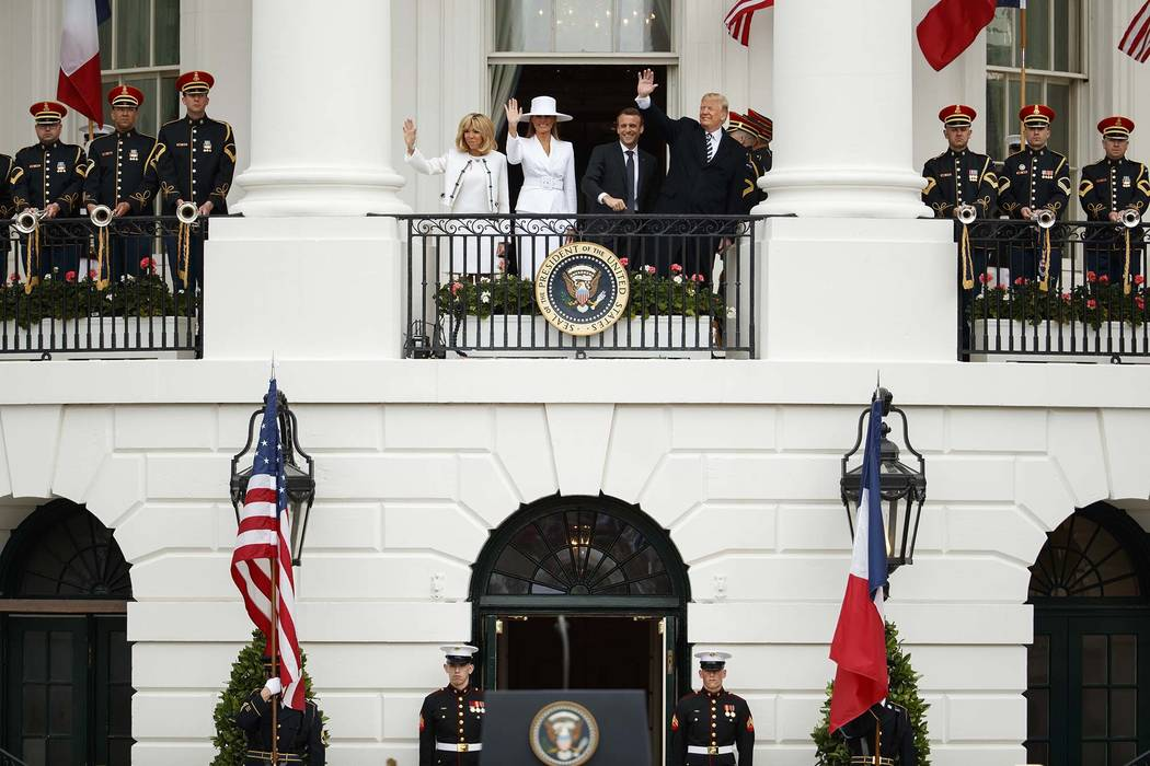 Brigitte Macron, first lady Melania Trump, French President Emmanuel Macron, and President Donald Trump wave during a State Arrival Ceremony on the South Lawn of the White House, Tuesday, April 24 ...
