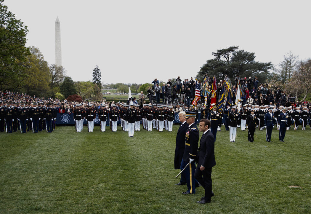 President Donald Trump and French President Emmanuel Macron review troops during a State Arrival Ceremony on the South Lawn of the White House in Washington, Tuesday, April 24, 2018. (AP Photo/Car ...