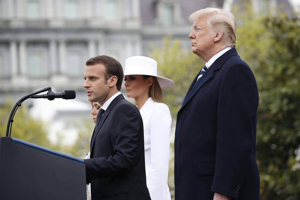 President Donald Trump listens as French President Emmanuel Macron speaks during a State Arrival Ceremony on the South Lawn of the White House in Washington, Tuesday, April 24, 2018. (AP Photo/Pab ...