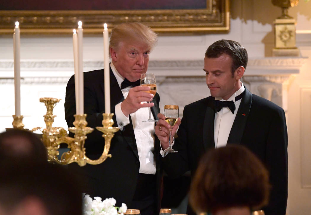 President Donald Trump and French President Emmanuel Macron toast in the State Dining Room during a State Dinner at the White House in Washington, Tuesday, April 24, 2018. (AP Photo/Susan Walsh)