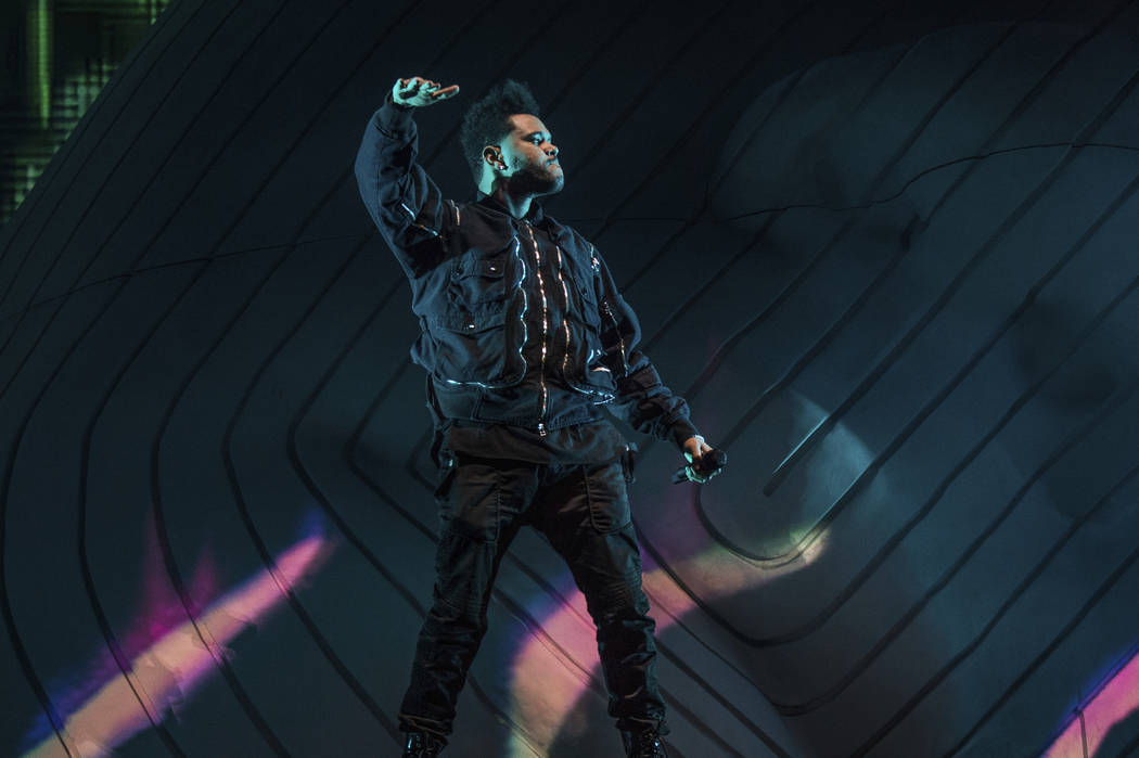 The Weeknd performs at the Coachella Music & Arts Festival at the Empire Polo Club on Friday, April 20, 2018, in Indio, Calif. (Photo by Amy Harris/Invision/AP)