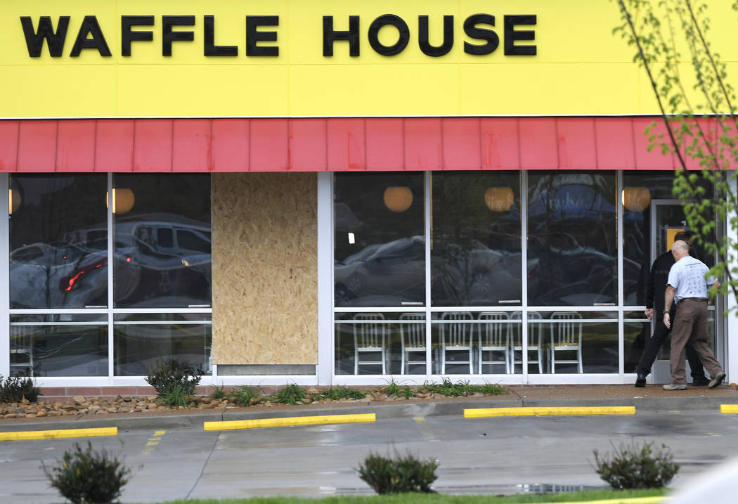 A window is boarded up at the Waffle House which remains closed Monday, April 23, 2018, after several people were shot and killed by a gunman early Sunday morning in Nashville, Tenn. The suspect i ...