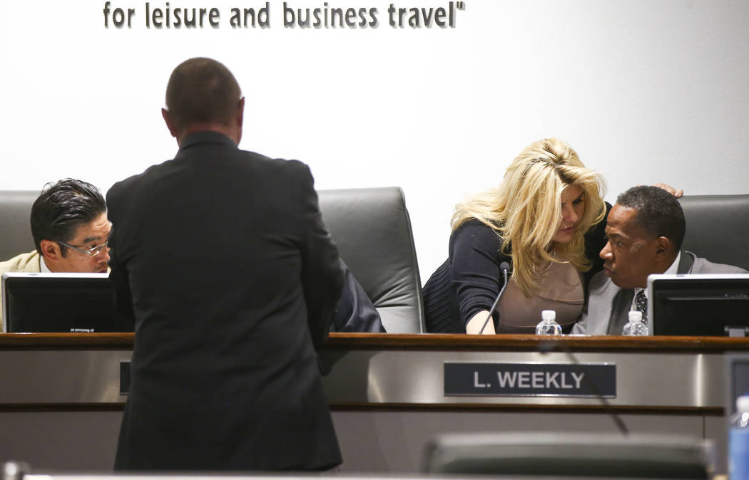 Las Vegas Convention and Visitors Authority board members Michele Fiore, third from left, and Lawrence Weekly talk after a meeting of the LVCVA's audit committee at the Las Vegas Convention Center ...