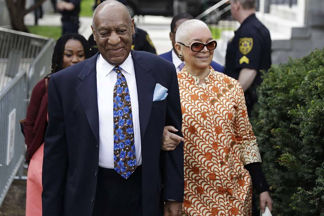 Bill Cosby, left, arrives with his wife, Camille, for his sexual assault trial, Tuesday, April 24, 2018, at the Montgomery County Courthouse in Norristown, Pa. (Matt Slocum/AP)