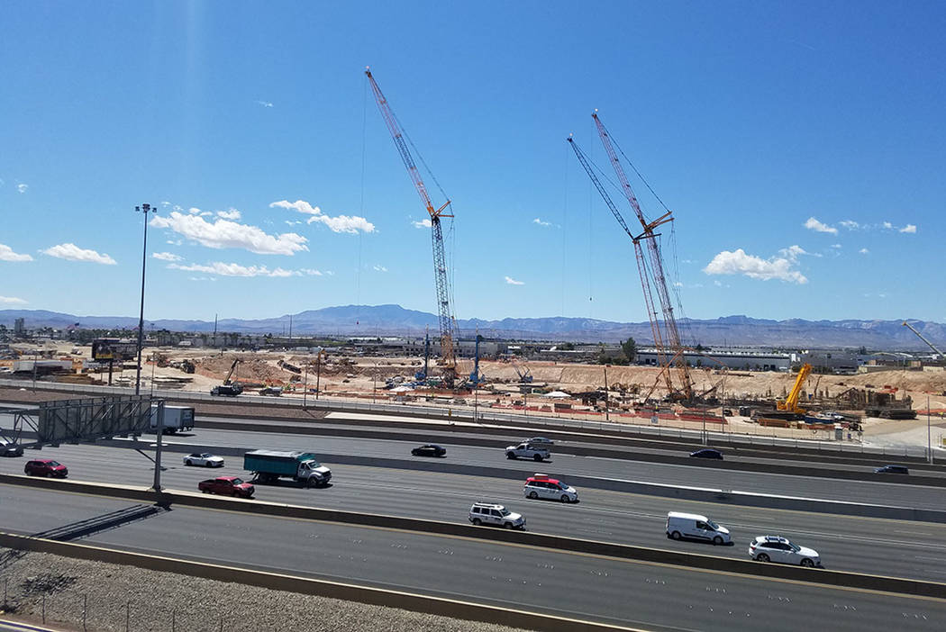 Three construction cranes tower over the Las Vegas Stadium construction site at Interstate 15 and Russell Road Friday, April 20, 2018. (Richard N. Velotta/Las Vegas Review-Journal)