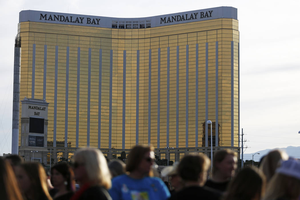 Attendees gather for the Route 91 Candlelight Vigil near Mandalay Bay in Las Vegas on Sunday, April 1, 2018. Andrea Cornejo Las Vegas Review-Journal @dreacornejo